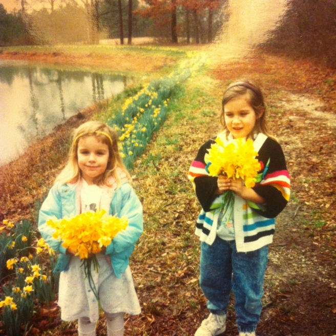 two young girls picking jonquils